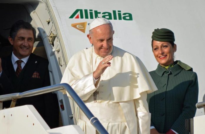 Pope Francis boards an airplane at Leonardo Da Vinci in Rome's Fiumicino international airport, on his way to Tbilisi, Georgia, Friday, 30 September, 2016. The pontiff is traveling to Georgia and Azerbaijan for a three-day visit