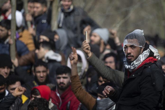 EDIRNE, TURKEY - MARCH 02: Irregular migrants continue to wait at the Pazarkule Border Gate in Karaagac neighbourhood in Edirne, Turkey to reach Greece on March 02, 2020.